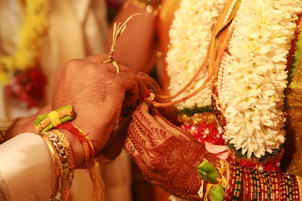 Placing kumkum on Mangal Sutra by the groom